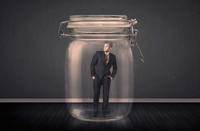 A businessman trapped inside a mason jar.